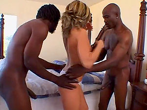 Madison Monroe deepthroats a Big black cock while getting another one drilling her beaver