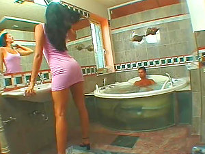 Monica Sweetheart deep throats a manstick in the bathroom and gets fucked from behind