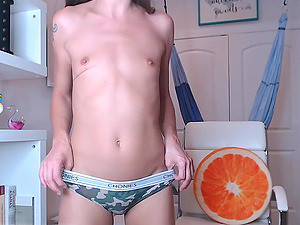 Thin camgirl with small tits masturbating and chating in front of the webcam