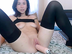 Brunette Russian camgirl in stocking plays with fuckmachine in front of the webcam