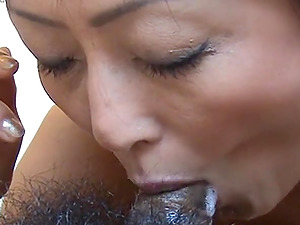 Asian wife loves to suck a big cock very deeply.