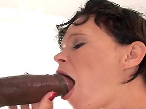 Big Titty Mummy Deep throats A Black Dick.