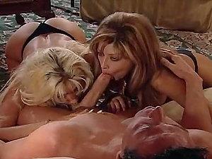 Horny blonde chicks feeding off a big hard-on here