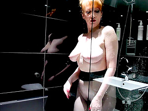 Redheaded Sluts Showers With Nylons On