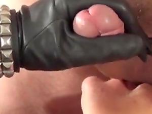 Amateur milf in leather gloved sucks her man