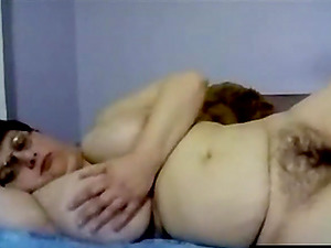 Hairy mature really enjoys toying her big fat shaved pussy