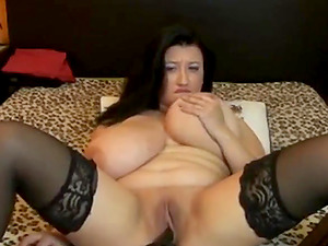 Fat brunette with enormous juggs teases and masturbates on livecam