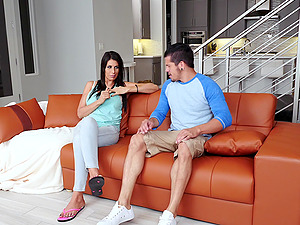 Handsome guy fucks a brunette cutie on the couch until he cums