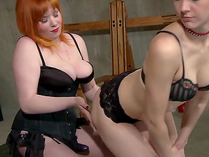 Dominant redhead makes her slave's ass turn red from spanking