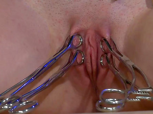 He ties her up to a chair and covers her tits in hot wax