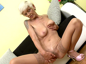 Mature short haired blonde Irenka S. exposes her saggy tits and ass