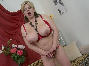 Big tited blonde MILF Flavia sucks a dildo from in between her boobs