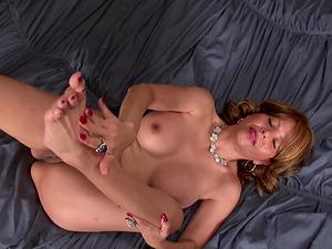 Amateur brunette mature model Joan undresses slowly at her house