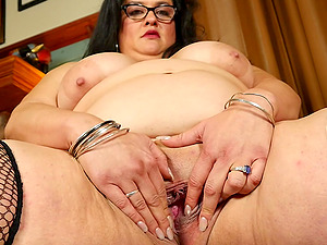 Buxom mature long haird librarian Allison masturbates at her workplace