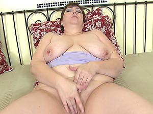 Short haired buxom mature amateur busty BBW Kaili squeezes her tits