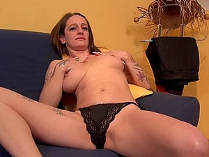 Tattooed mature amateur MILF Adrienne Kiss exposes her shaved pussy