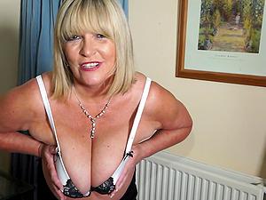 Buxom mature amateur blonde Alisha Rydes masturbates with a huge dildo