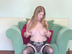 Mature redhead amateur British granny Lily May masturbates on a chair