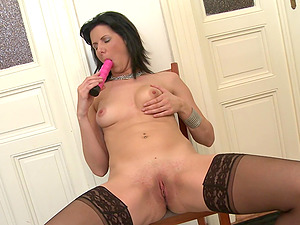 Dark haired stylish mature MILF Phylis strips at home