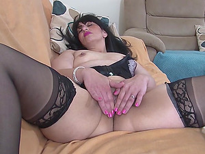 Dark haired mature amateur British MILF Alyshia strips in pantyhose