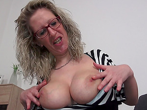 Mature curly haired blonde German MILF Jana masturbates furiously