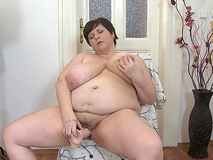 Short haired busty mature amateur BBW Felicia W. has fun with a dildo
