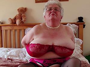 Mature amateur buxom British short haired granny Caroline V.