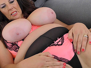 Amateur mature busty British MILF Lulu swallows a huge dildo