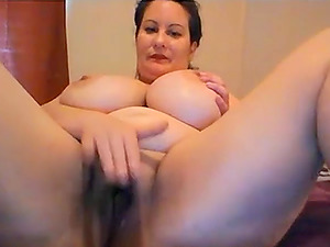 Beautiful milf with enormous juggs teases and masturbates