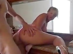 Beautiful blonde milf naughty in the kitchen
