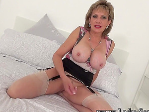 Lady Sonia playing with her big tits
