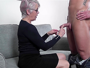 Mature short haired granny Lady Sextacy makes a cock cum with her feet