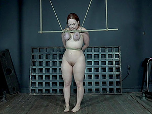 Redhead pale MILF slut Summer Hart has her tits tortured in bondage
