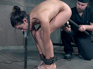 Drooling brunette slave Eden Sin pussy tortured in chains