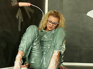 Curly haired blonde with glasses gets messy at the glory hole