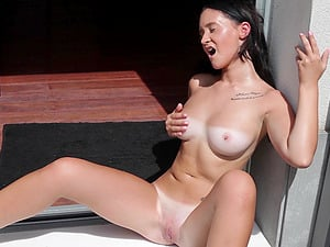 Busty dark haired Gina Ferocious shows off her huge tits with tanlines