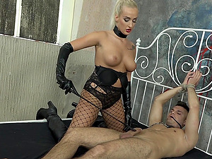 Blonde MILF mistress Daisy Lee rides a tied up well hung guy
