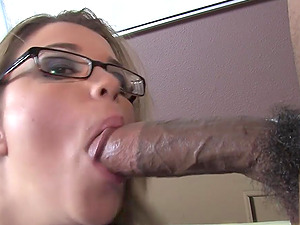 Blonde amateur with glasses Katie Thomas gobbles on a huge dick