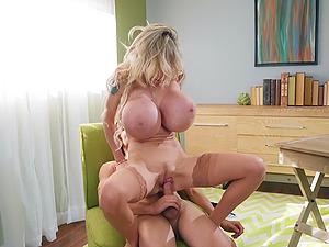 Horny secretary Danielle Derek gets cum in between her huge fake boobs