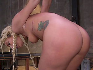 Blonde beauty Luca Bella tied up, ball gagged and fucked on the table