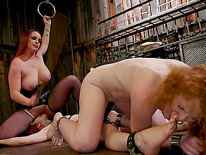 Kinky tied up lesbian strap on threesome with Bella Rossi at a barn