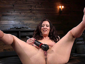 Solo brunette fetish model Cherry Torn plays with a vibrator
