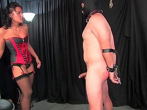 Brunette Mistress Haley spanks and pegs her mature male slave