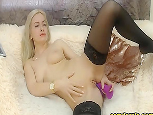 Seductive blonde has a passion for lipsticks and for sex toys