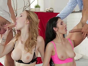 Belle Claire and another horny girl enjoy hardcore foursome on the bed