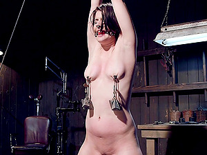 Incent looking girl Katharine Cane gives herself fully to be tortured