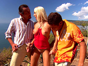 Diana Gold blowing her friend's oversize penis during a threesome