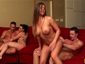 Two Sexy Huge-titted Wives Interchange Hubbies on a Crimson Couch