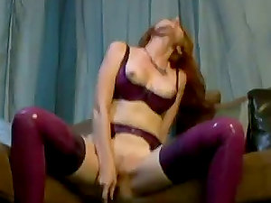 Ginger-haired Kendra James Masturbating and Showcasing Off Her PVC Suit