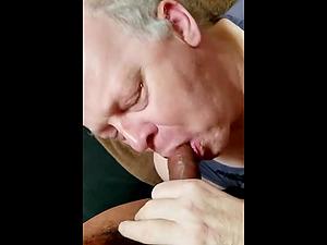 Horny older man sucks yound black cock